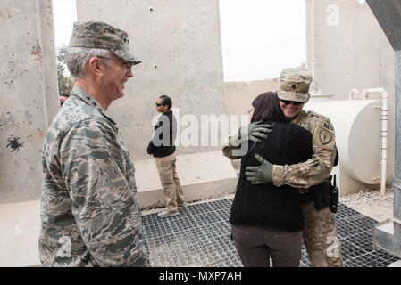 Mrs. Ricki Selva, wife of U.S. Air Force Gen. Paul J. Selva, vice chairman of the Joint Chiefs of Staff, hugs a U.S. Army military policeman, right, at Kandahar Airfield, Afghanistan, Nov. 24, 2016. Gen. Selva and Mrs. Selva visited troops across Afghanistan to spend Thanksgiving Day with them and thank them for their service. (DoD Photo by U.S. Army Sgt. James K. McCann) - Stock Photo