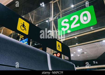 Empty Priority seats, chairs in the departure hall gate at international airport reserved for disability - Stock Photo