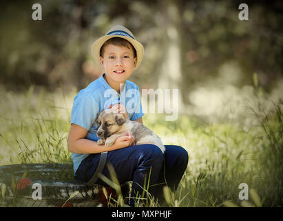 cute boy with a dog - Stock Photo