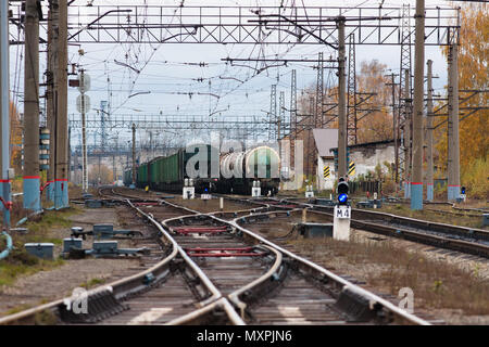 Freight trains and railway switch on city cargo station - Stock Photo