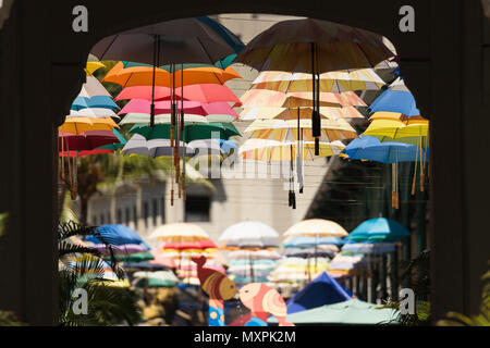 Rows of umbrellas hanging above a street in the Caudan Waterfront, Port Louis, Mauritius. - Stock Photo