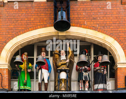 Chiming clock with male and female figures above clock makers shop, Southgate Street Gloucester UK May 2018. - Stock Photo