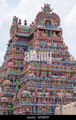 Part of an ornately carved and vividly painted entrance gateway, or Gopuram, at the Ranganathaswamy temple at Srirangam at Trichy in Tamil Nadu, India - Stock Photo