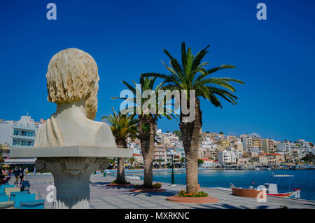 Sitia Crete March 10 2018- bust of ancient greek wise man called Mison is looking at the picturesque city of Sitia. - Stock Photo