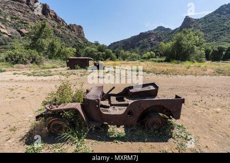 Vintage ruined military vehicles on display at Malibu Creek State Park near Los Angeles, California. - Stock Photo