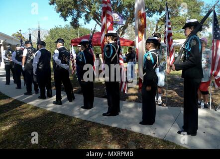 "Members of the Rolling Thunder Florida Chapter 11, and the Riverview High School Navy Junior Reserve Officers' Training Corps prepare to present the colors during the Pearl Harbor Remembrance Day ceremony at Veterans Memorial Park in Tampa, Fla., Dec. 7, 2016. Service members, veterans, retirees and civilians gathered to commemorate the 75th anniversary with a ceremony themed ""We Remember the Fallen."" (U.S. Air Force photo by Senior Airman Vernon L. Fowler Jr.) - Stock Photo"