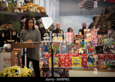 First Lady Michelle Obama gives a speech about the importance of the Toys for Tots program at Joint Base Anacostia-Bolling, Dec. 7, 2016. The Marine Corps Reserve Toys for Tots program was created in 1947 and provides new, unwrapped toys to millions of children across the country every year. The first lady is an avid supporter of Toys for Tots and has been a spokesperson for its mission for the last eight years. (U.S. Marine Corps photo by Lance Cpl. Jamie L. Arzola) - Stock Photo