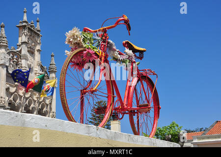 Old style bright red bicycle on display, Sintra (near Lisbon), Portugal - Stock Photo