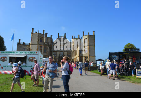 Couple with ice creams at Sherborne Castle Country Fair, Sherborne Castle, Dorset, England - Stock Photo