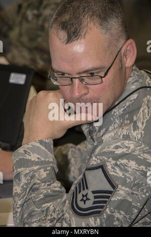 Master, May 16, 2018. Sgt. Branson Bentley, an Information Protection Technician, scans his network for potential threats during Cyber Shield, on Wednesday May 16, at Camp Atterbury, Ind. Cyber Shield 18 is an Army National Guard exercise designed to assess Cyber Warriors on response plans to cyber incidents and features over 800 Soldiers and Airmen. (U.S. Army Photo by Spc. Michael Hunnisett). () - Stock Photo