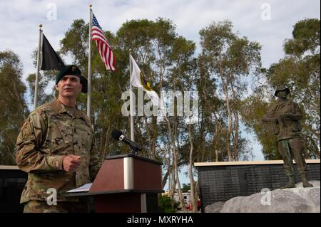 Army Command Sgt. Maj. Patrick McCauley, U.S. Special Operations Command senior enlisted leader, speaks during a Memorial Day observation at the Special Operations Memorial on MacDill Air Force Base, Fla. May 24, 2018, May 24, 2018. The federal holiday serves as a time to honor service members who died while serving in the armed forces. (Photo by U.S. Air Force Master Sgt. Barry Loo). () - Stock Photo
