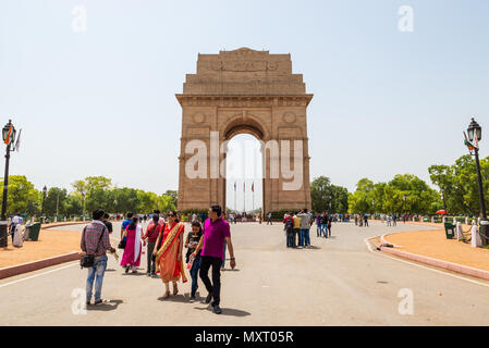 NEW DELHI, INDIA - CIRCA APRIL 2017: Tourists visiting India Gate. India Gate is a war memorial for soldiers who died during the First World War. - Stock Photo
