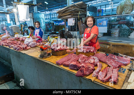 Woman selling meat on market stall, Nakhon Phakom, Thailand - Stock Photo