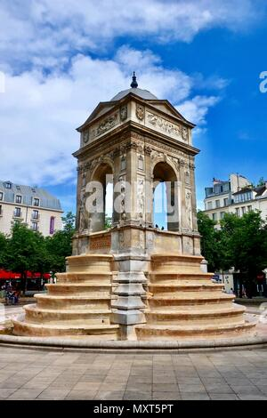 Paris, France. Hot bright sunny spring day, May 2018. Fontaine des Innocents in Les Halles. - Stock Photo