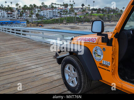 San Clemente Beach Destination - lifeguards get ready for swimmers and surfers, get ready to surf on Orange County California waves - Stock Photo