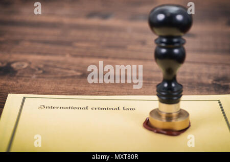 International criminal law, legality concept, notary seal, law and justice concept. - Stock Photo