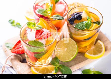Lemonade set. Iced lemonade with strawberry, raspberry and blueberry with orange, lime and lemon. - Stock Photo