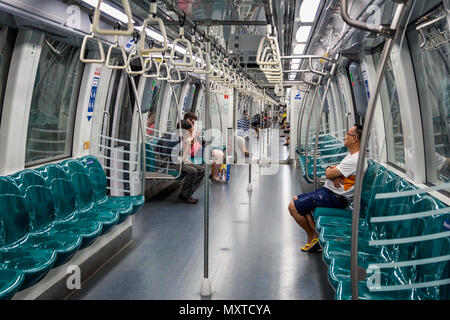 train carriage interior on Singapore Mass Rapid Transport system taken in Singapore, Asia on 28 October 2013 - Stock Photo