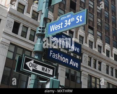 Seventh Ave and West 34th Street signs in New York City - Stock Photo