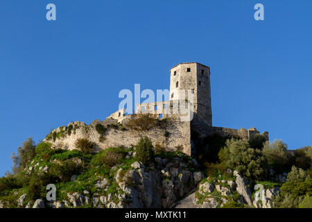 The Kula, overlooking the remains of Počitelj, a UNESCO-protected town, Federation of Bosnia and Herzegovina. - Stock Photo