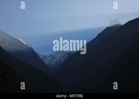 Sunrise over mount Machapuchare, Annapurna Conservation Area, Nepal. - Stock Photo
