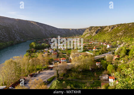 The modern part of Počitelj, a UNESCO-protected town, Bosnia and Herzegovina and the river Neretva. - Stock Photo