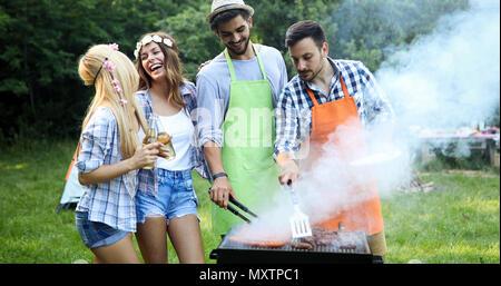 Handsome male preparing barbecue - Stock Photo