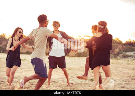 Image of happy cheerful young loving couples friends outdoors on the beach have fun. - Stock Photo