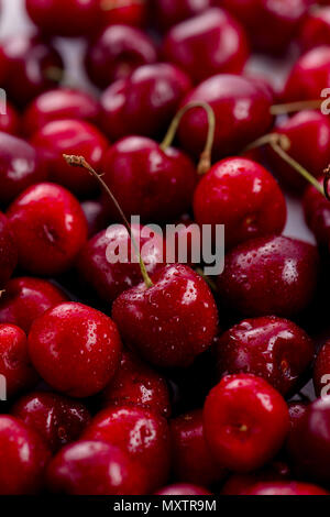 Cherries with water drops close-up. Macro berries shot with copy space - Stock Photo