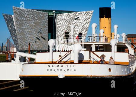 The Nomadic ships docked at Titanic Belfast exhibition - Stock Photo