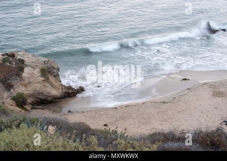 Waves crashing at the beach - Stock Photo