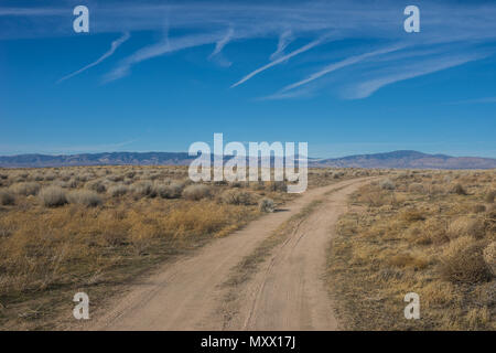Dirt road in the California wilderness on the edge of the Mojave Desert north of Los Angeles. - Stock Photo