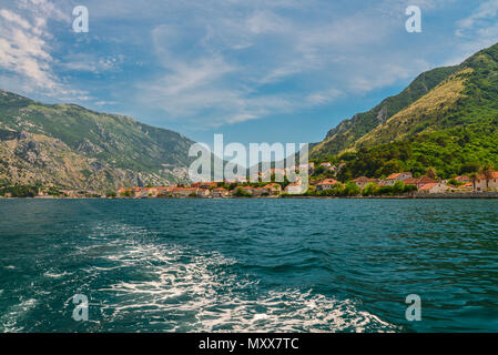 Waterfront of small town Prcanj along Bay of Kotor, Montenegro. - Stock Photo
