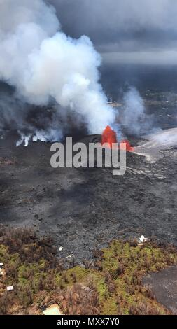 Aerial view of a massive lava fountain spewing magma 230 feet into the air from fissure 8 in the Vacationland area caused by the eruption of the Kilauea volcano June 3, 2018 in Hawaii. The recent eruption continues destroying homes, forcing evacuations and spewing lava and poison gas on the Big Island of Hawaii. - Stock Photo