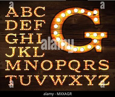 Vector of letters in retro style old lamp alphabet for light board on wood background. - Stock Photo
