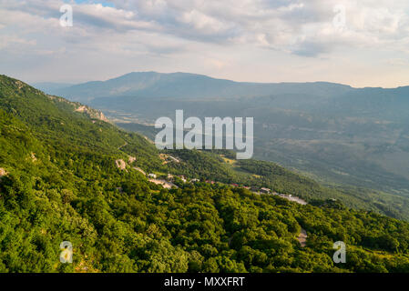 View on mountains from Ostrog monastery in Montenegro at sunset - Stock Photo