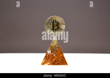 Bitcoin Coin sitting a top a translucent Onyx Stone. Stone symbolizes, personal power, change, facing fears.  All things people who trade crypro face - Stock Photo
