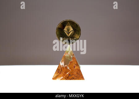 Ethereum Coin sitting a top a translucent Onyx Stone. Stone symbolizes, personal power, change, facing fears.  All things people who trade crypro face - Stock Photo