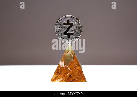 ZCash Coin sitting a top a translucent Onyx Stone. Stone symbolizes, personal power, change, facing fears.  All things people who trade crypro face - Stock Photo