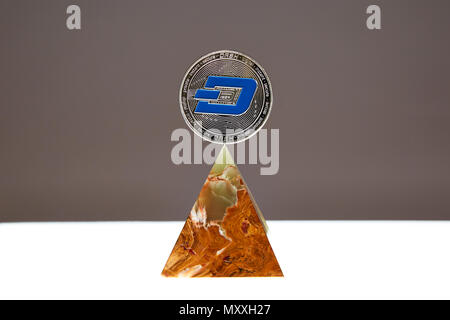 Dash Coin sitting a top a translucent Onyx Stone. Stone symbolizes, personal power, change, facing fears.  All things people who trade crypro face - Stock Photo