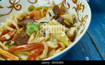 Uzbek Qorasaroy Lagmon , Traditional assorted dishes, Top view.  Central Asian cuisine - Stock Photo