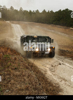 U.S. Marines with 2nd Marine Logistics Group drive through the Combat Vehicle Operators Training Course using Humvees on Camp Lejeune, N.C., Dec. 6, 2016. The course was created to increase Marines confidence while operating on various types of terrain. (U.S. Marine Corps photo by Lance Cpl. Tyler W. Stewart) - Stock Photo