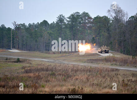 A M1A2 Abrams Main Battle Tank from 2nd Battalion, 7th Infantry Regiment engages a target with a 120mm main gun during their Gunnery Table VI engagements at Fort Stewart, Georgia Dec. 5. Tank crews from throughout 1st Armored Brigade Combat Team, 3rd Infantry Division are competing for bragging rights as tank crews look to qualify and prepare for future collective training. (U.S. Army photo by Maj. Randy Ready) - Stock Photo