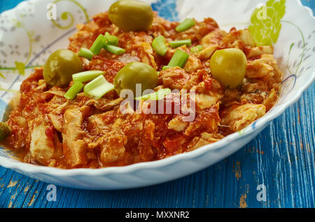 Bacalao a la Vizcaíba - Salt cod appears on Christmas Eve tables throughout Mexico, version of salt cod with almonds and olives comes - Stock Photo