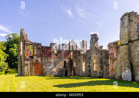 The ruins of Netley Abbey monastery near Southampton against blue sky in May 2018 -  the ruins are an English heritage site in Hampshire, England, UK - Stock Photo