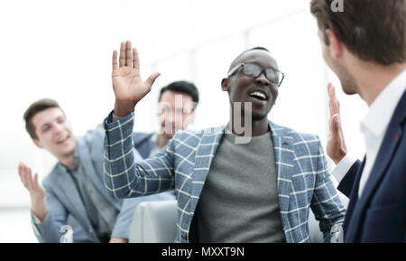 successful employees giving each other a high five - Stock Photo