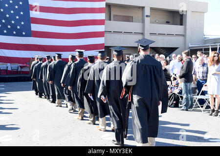 161214-N-AV746-091 CORONADO, Calif. (Dec. 14, 2016) Sailors, assigned to Naval Special Warfare, make their entrance for a graduation ceremony at Naval Base Coronado. Twenty-eight Navy SEALs and Special Warfare Combatant Craft Crewmen received bachelor's degrees in organizational leadership and one operator earned his master's degree in strategic leadership from the University of Charleston. (U.S. Navy photo by Petty Officer 2nd Class Timothy M. Black/Released) - Stock Photo