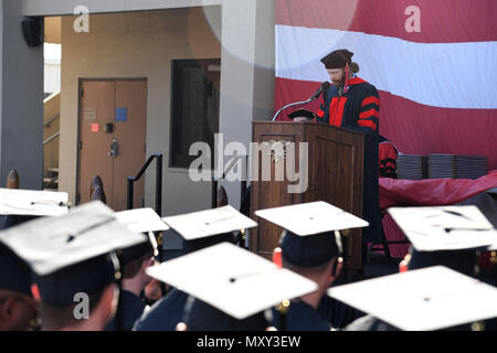 161214-N-AV746-191 CORONADO, Calif. (Dec. 14, 2016) Dr. John Lee, adjunct faculty at the University of Charleston, leads the invocation during a graduation ceremony at Naval Base Coronado. Twenty-eight Navy SEALs and Special Warfare Combatant Craft Crewmen received bachelor's degrees in organizational leadership and one operator earned his master's degree in strategic leadership from the University of Charleston. (U.S. Navy photo by Petty Officer 2nd Class Timothy M. Black/Released) - Stock Photo