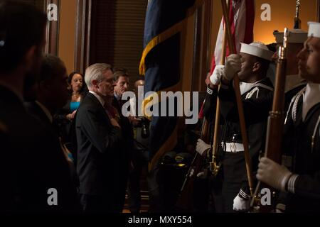 161214-N-JC800-011 WASHINGTON (Dec. 14, 2016) Secretary of the Navy Ray Mabus salutes the flag during a ship naming ceremony at City Hall in Washington, D.C. Dec. 14. The ships that were named were the first of its class ballistic-missile submarine USS Columbia (SSBN 862), the future Spearhead-class expeditionary fast transport ship USNS Puerto Rico (T-EPF 11) and John-Lewis class fleet replenishment oilers USNS Earl Warren (T-AO 207). (U.S. Navy photo by Petty Officer 2nd Class Heath Zeigler/Released) - Stock Photo