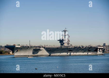 161219-N-OI558-339  SAN DIEGO (Dec. 19, 2016) USS Theodore Roosevelt (CVN 71) departs Naval Base Coronado for its first underway period since arriving at its new homeport in San Diego. (U.S. Navy photo by Seaman Chanel Turner/Released) - Stock Photo